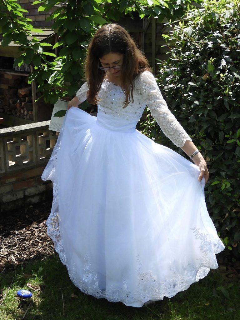Laura in wedding Wingz